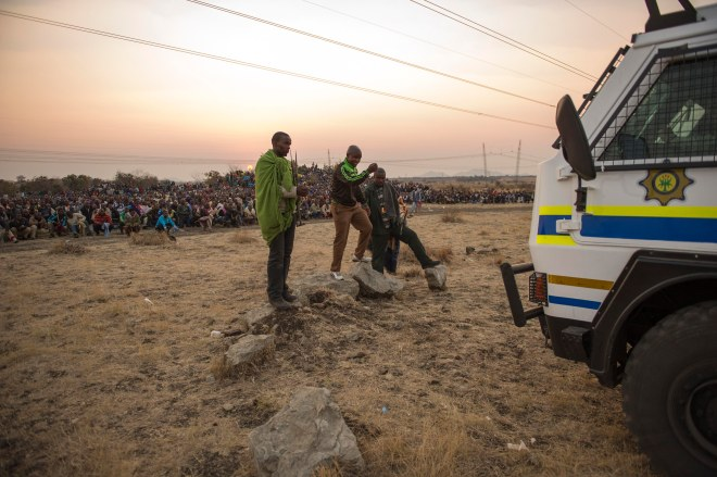 Lonmin employees gather on a hill called Wonderkop at Marikana, outside Rustenburg in the North West Province of South Africa on 15 August 2012. They were calling for the minimum wage to be lifted from R4 000 a month to R12 500.. (Photographer: Greg Marinovich).